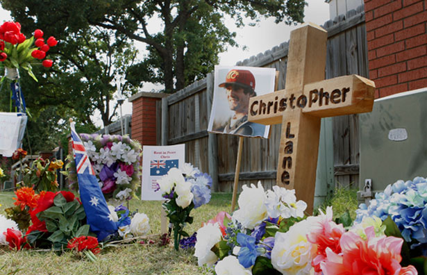 A memorial is seen at the scene where Australian college student Christopher Lane, 23, of Melbourne, was found dead of a gunshot wound on Friday in Duncan, Oklahoma, August 21, 2013. (REUTERS/Bill Waugh)