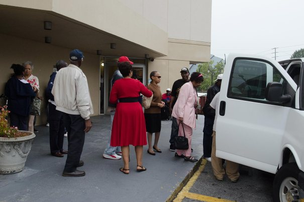 Elderly voters board a van that will take them to a polling station in Atlanta on the first day of early voting, Oct. 13, 2014. via Al Jazeera America