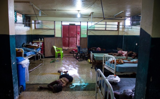 Two people lay dead on the floor Sept. 20 inside a ward at the Redemption Hospital, which has become a transfer and holding center for Ebola patients in the New Kru Town slum of Monrovia, Liberia.