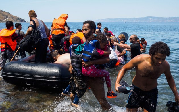 Refugees arriving on the isle of Lesbos in a dinghy from Turkey. (Lazar Simeonov)