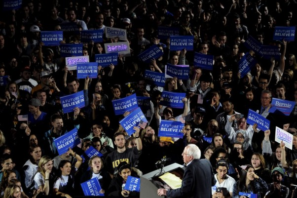 The crowd cheers as U.S. Democratic presidential candidate Bernie Sanders speaks at a campaign rally and concert at the University of Iowa in Iowa City, Iowa January 30, 2016. REUTERS/Mark Kauzlarich - RTX24R4K