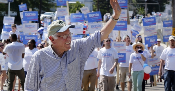Democratic presidential candidate Senator Bernie Sanders waves as he marches with supporters in the Labor Day parade. (Photo: AP/Jim Cole)