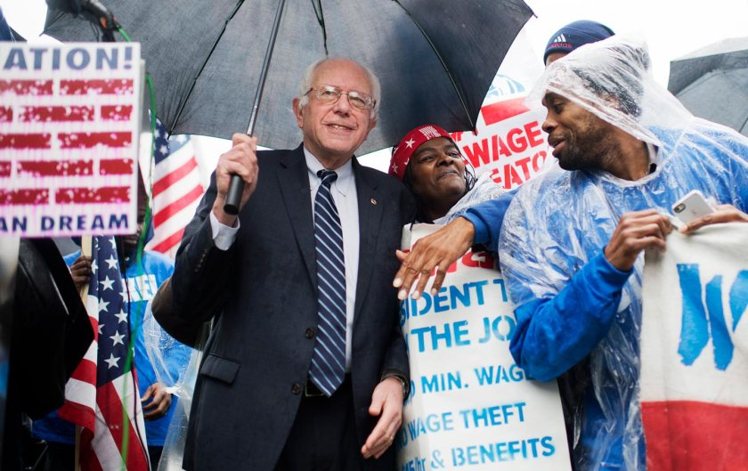 Bernie Sanders attends a rally in Upper Senate Park with striking workers to call for a minimum wage of $15 per hour, November 10, 2015. (Tom Williams / CQ Roll Call via AP Images)