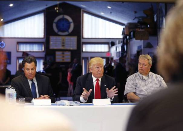 Donald Trump meets with active and retired law enforcement officials at the Fraternal Order of Police in Akron, Ohio, in August.
