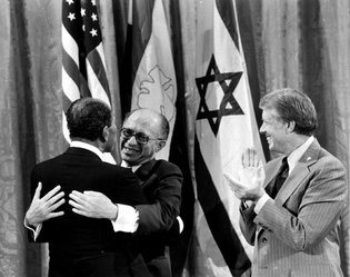 From left, President Anwar Sadat of Egypt, Prime Minister Menachem Begin of Israel and President Jimmy Carter of the United States in 1978 during the White House announcement of a Middle East peace agreement reached at Camp David.