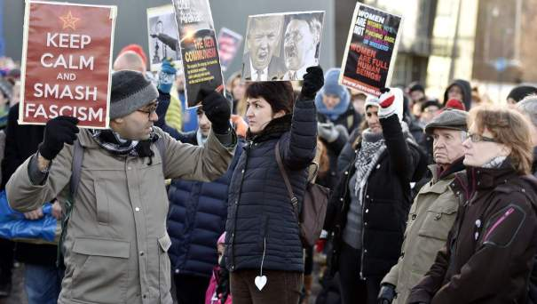 A participant of a Women's March in Helsinki holds up a poster depicting US President Donald Trump and German dictator Adolf Hitler on January 21, 2017, one day after the US president's inauguration. / AFP PHOTO / Lehtikuva / Jussi Nukari / Finland OUTJUSSI NUKARI/AFP/Getty Images NYTCREDIT: Jussi Nukari/Agence France-Presse -- Getty Images