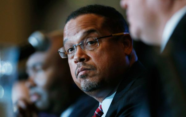 In December of 2016, Keith Ellison listens as Ray Buckley speaks during a forum on the future of the Democratic Party. (AP Photo / David Zalubowski)